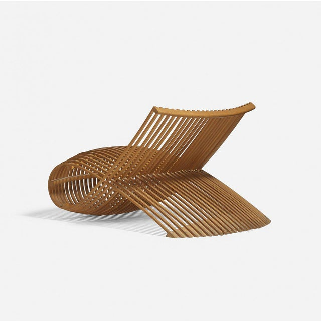 Marc Newson wooden slatted lounge chair.