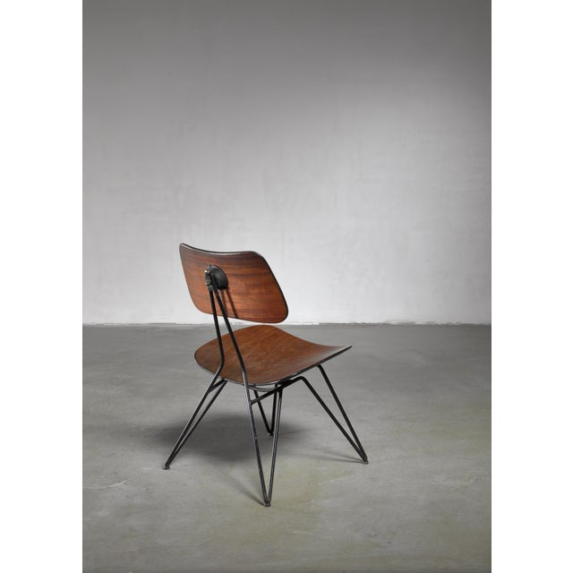 A model DU10 sidechair designed in 1951 by Gio Ponti and Gastone Rinaldi for Rima. The chair has a bent plywood seating...