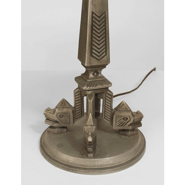 """American Art Deco (1920s) """"Aztec Design"""" silvered metal table lamp with a geometric base and a green & gold painted and..."""