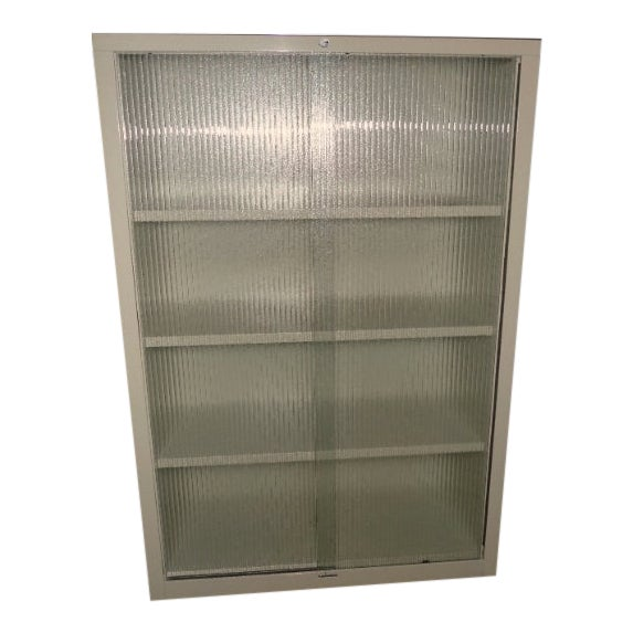 Mid-Century Steelcase Storage Cabinet With Sliding Ribbed-Glass Doors For Sale