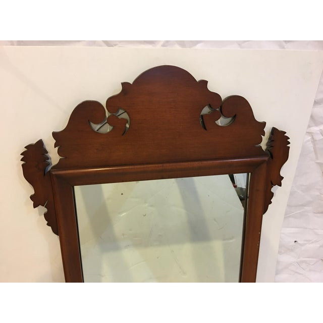 A beautiful vintage? Chippendale style wall mirror. Clean shape with wonderful details. A great traditional decor accessory.