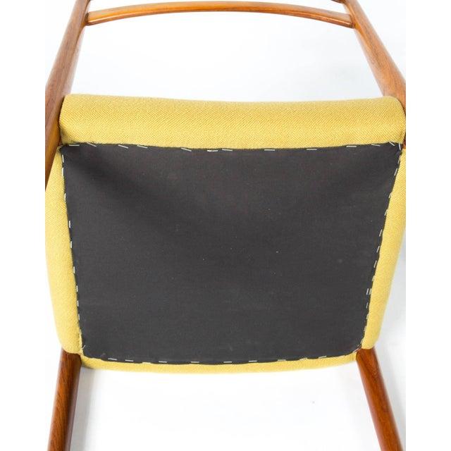 Four 1960s yellow original fabric rosewood Danish modern chairs. Elegant design.