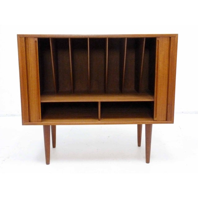 Circa 1960 rare Danish Modern teak record cabinet with tambour doors by Povl Dinesen. Back of cabinet stamped Povl...
