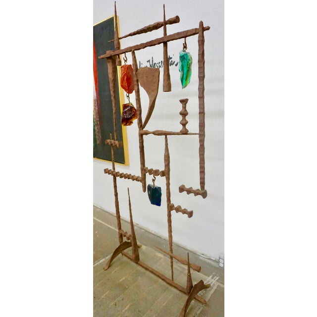 Sculptural welded, hammered iron and colored glass, free standing. Designed by David Palumbo,could be used as a room...