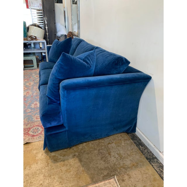 Nothing says glamour and romance quite like blue velvet! This generously sized sofa with high arms has been upholstered in...