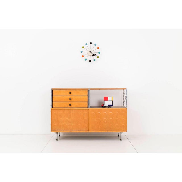 Charles and Ray Eames for Herman Miller. Model 220-N. This storage unit has a zinc-coated steel frame, maple-top and...
