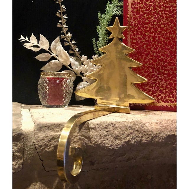 This is for one stocking hanger that is a solid brass Christmas tree. This measures: 6.5 inches tall x 5.75 inches wide x...