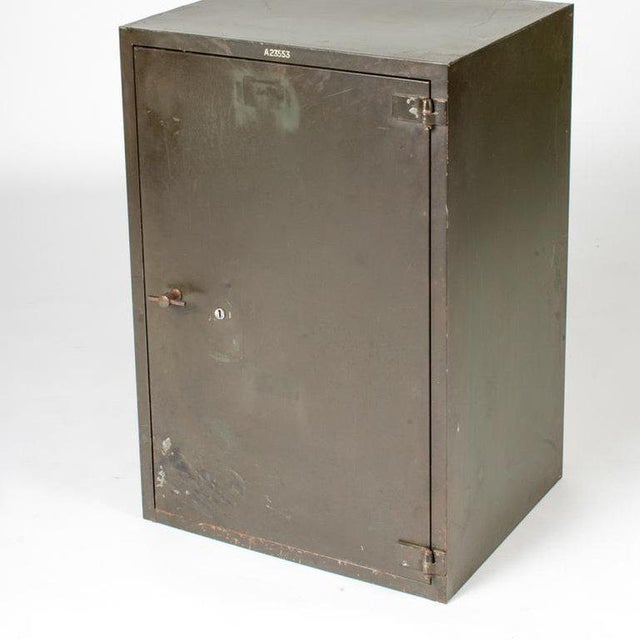 A single door steel cabinet, England, circa 1900.