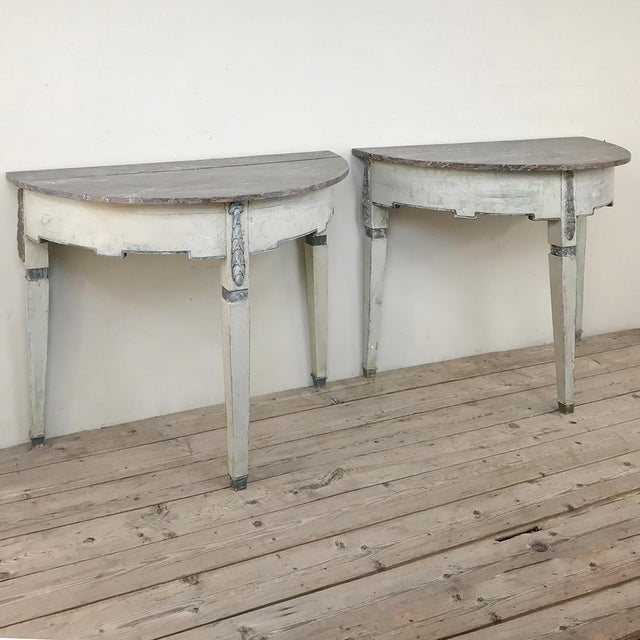 Pair 19th Century Swedish Painted Demilune Consoles represent the essence of the style, with tailored architecture and a...