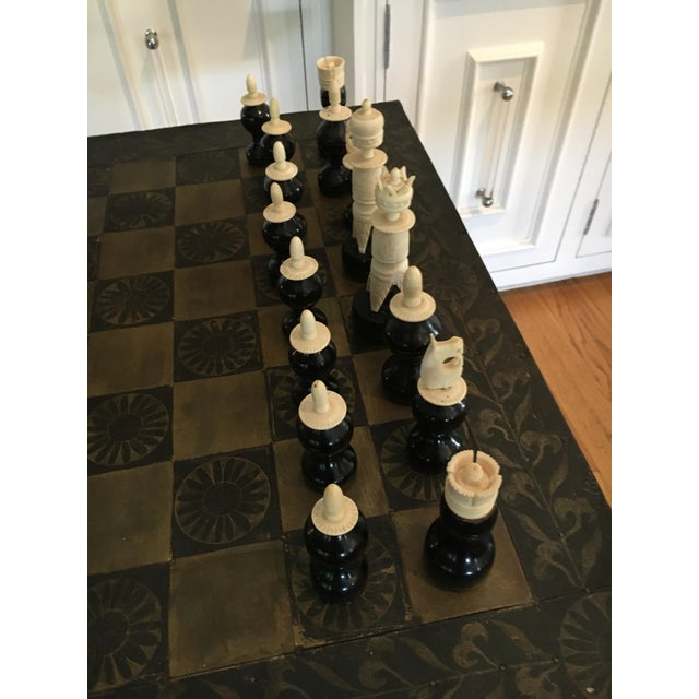 Metal Mexican chess board with hand-carved wooden chess men - the table is felt backed and can be removed to play on any...