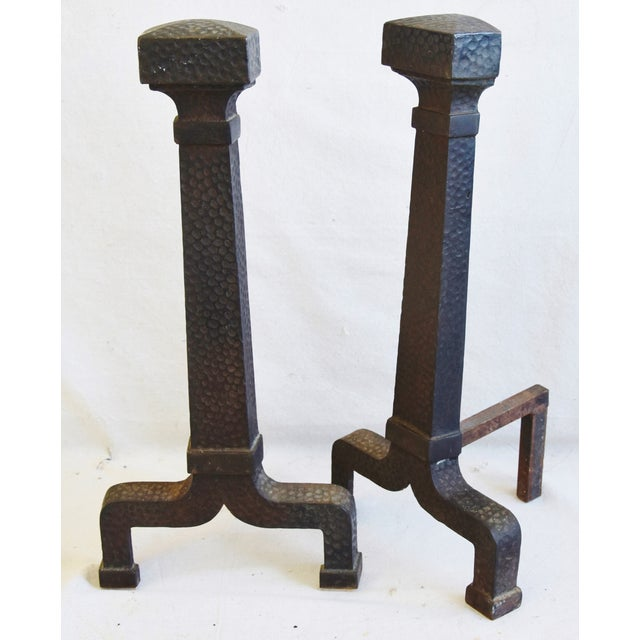 Pair of vintage early 1900s fireplace andirons. No maker's mark. Light wear consistent with age and use.