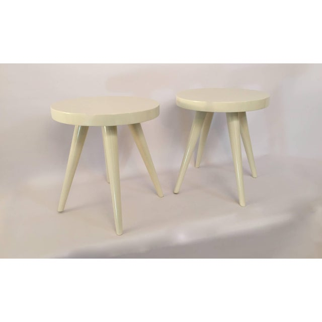 Excellent pair of four legged stools in the manner of Charlotte Perriand, circa 1950-1960. Thick solid wood top and...