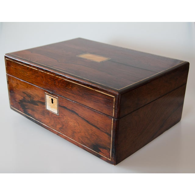 A superb 19th Century English Rosewood box with lock and key, circa 1870. This fine antique box is decorated with...