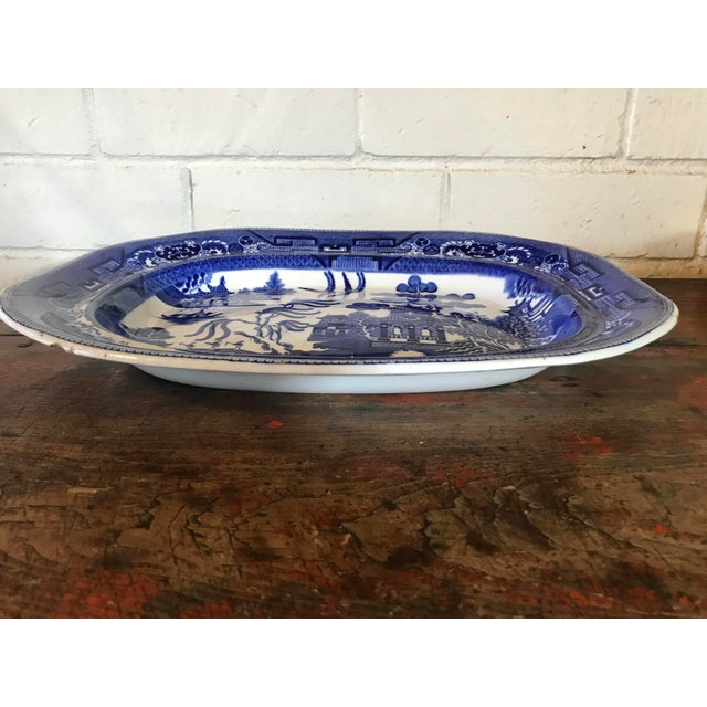 Gorgeous ironstone serving platter. Flow blue willow pattern. Illegible marking on backside. Made in England.