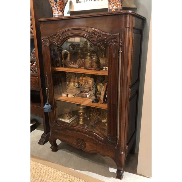 French Display Cabinet With decorative interior and wood shelves.