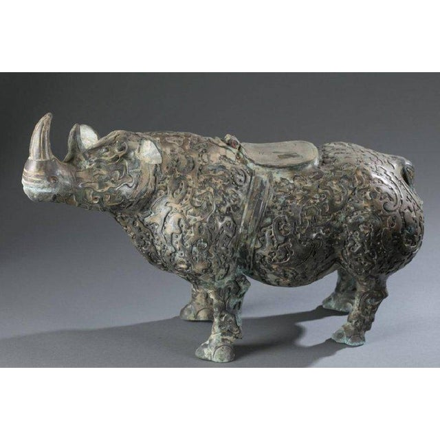 Incredible pair of bronze decorative Chinese rhinoceros statues. Impressive size and scale with beautiful decorative...