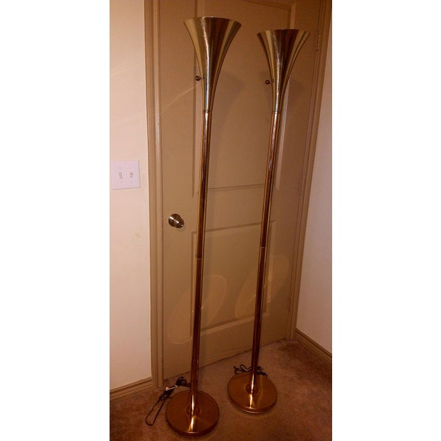 This is a pair of vintage brass torchiere floor lamps by Laurel Lamp Company. These 1960s sophisticated mid- century...