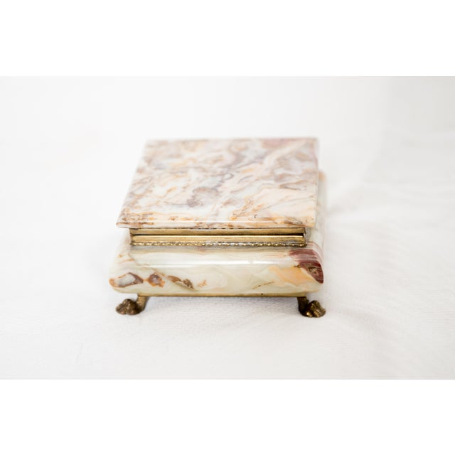 Vintage Italian marble onyx trinket box with claw feet. Box is lined with orange velvet.