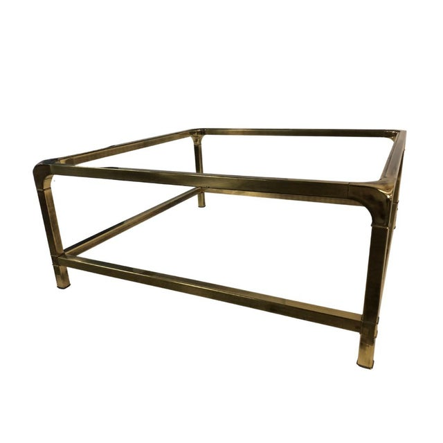 Classic Mastercraft brass coffee table with a glass top. In mint/excellent vintage condition! My favorite part of this...