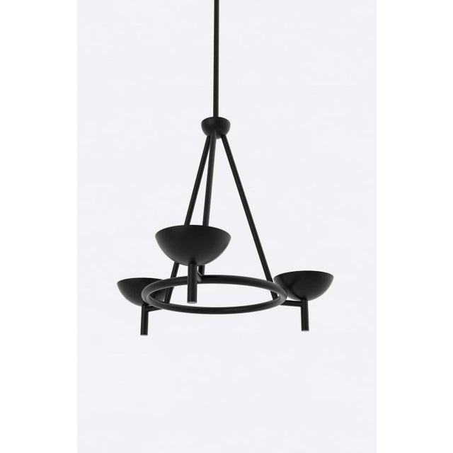 Orphan Work 200 chandelier BLK, 2020 Shown in blackened brass Available in brushed brass and blackened brass Measures:...