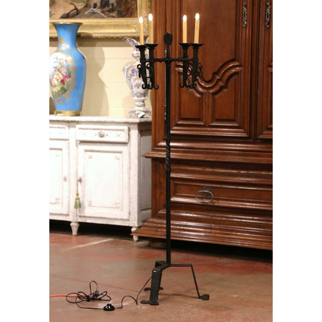 This elegant antique fixture was crafted in southern France, circa 1920. The Gothic candelabra lamp stands on a twisted,...