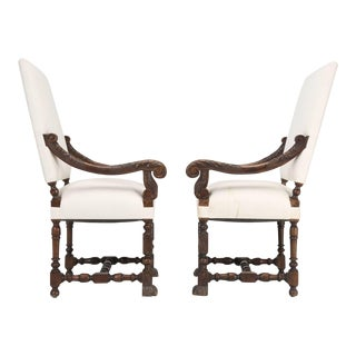 Antique French Carved Walnut Throne Armchairs - A Pair For Sale
