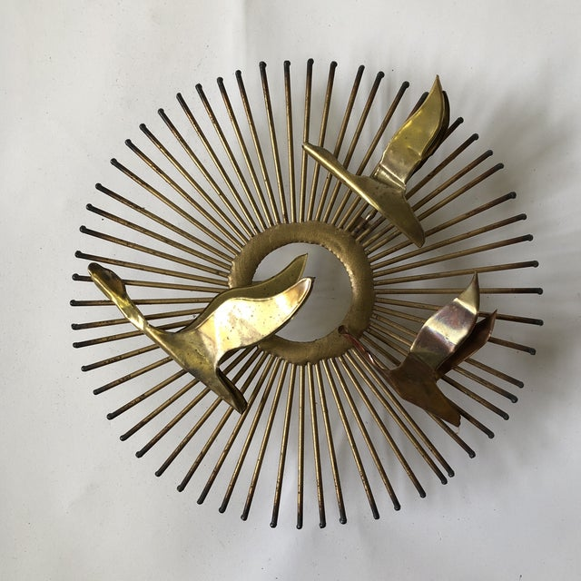 """Mid century Jere-era wall sculpture of brass in the iconic sunburst motif """"Birds of Flight"""" attributed to William Friedle."""