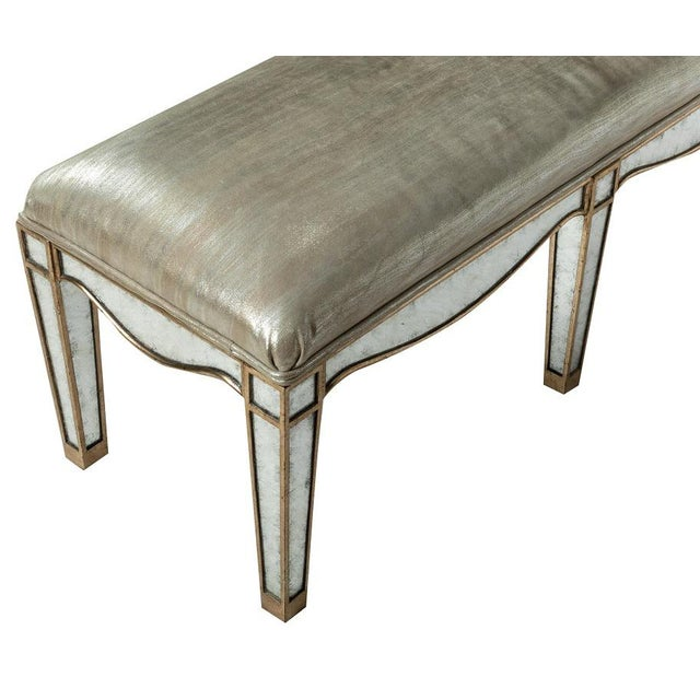 Giltwood Eglomise Venetian Style Mirrored Bench. Has the original upholstery. Frame is giltwood and eglomise mirror.