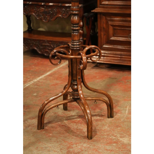 Bring a retro, yet practical touch to any entry or dressing area with this elegant, carved coat Stand. The useful hat rack...