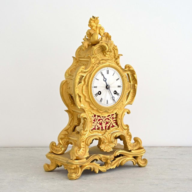 A beautiful antique Louis XVI style ormolu mantel clock with silvered 'engine turned' dial with Roman numerals, and...