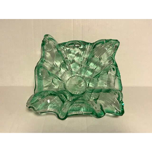For sale is a nice decorative bowl. Handblown glass of Murano italy. Green swirl design.