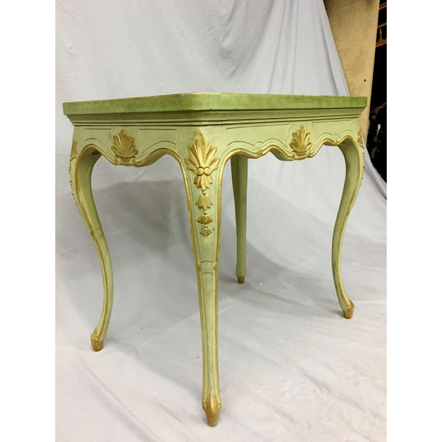 With a hand-painted finish and Louis XV design, this side table features a handsome antique furniture appeal. Cabriole...