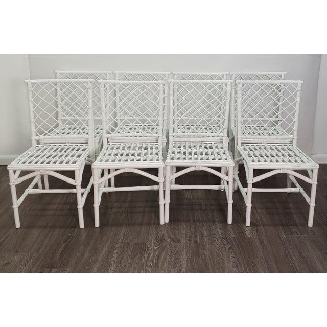 Set of 8 Ficks Reed Chippendale style Chairs. The Chairs have the Diamond Design in Rattan, enhanced with a fresh white...