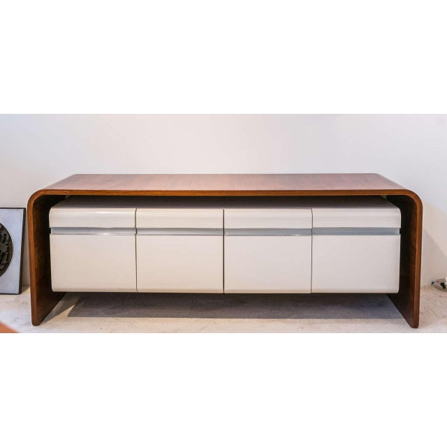 "A rare ""Directeur"" Credenza or Sideboard in walnut veneer, lacquered Formica, aluminum and brushed stainless steel. By..."