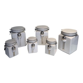 Vintage Country Canisters With Fasteners - Set of 6 For Sale