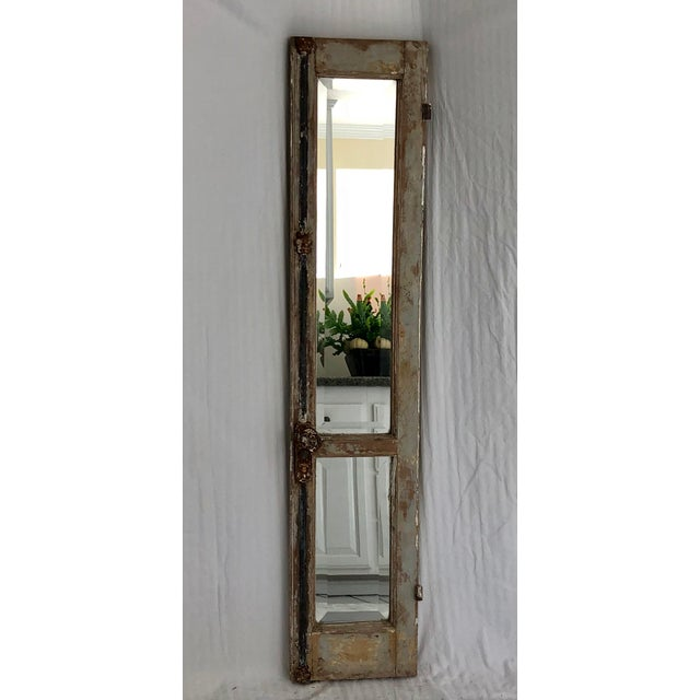 Antique Provence divided shutter has been given new life with beveled mirrors. Original hardware and paint give this piece...