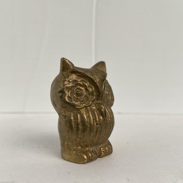 There is a rich patina on this tiny brass owl. Amazing paperweight or tiny object of art. Very versatile detail item...