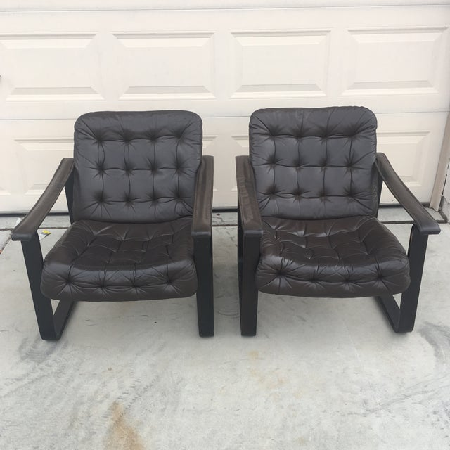 Mid century modern tufted espresso bent wood and leather sling chairs in excellent condition! Made in Finland.