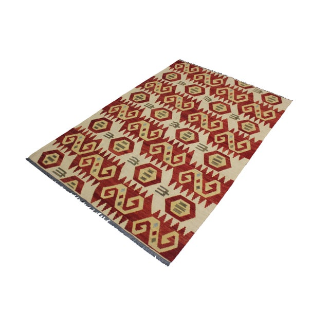 A beautiful traditional kilim, handmade by Aara Rugs. Geometric design. This kilim is made of 100% wool, dyed with all...