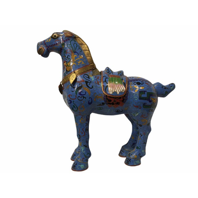 Beautiful vintage Chinese cloisonné horse figurine / statue. Features an enameled brass body of blue and gold tones. The...