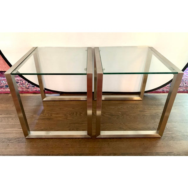 Pair of chrome and glass cube end tables have clean and simple lines that would fit any contemporary or mid century decor....