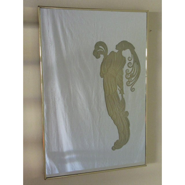Maurice Villency pair of Deco style mirrors with figures that light up. They have an inner bulb with a switch at the...