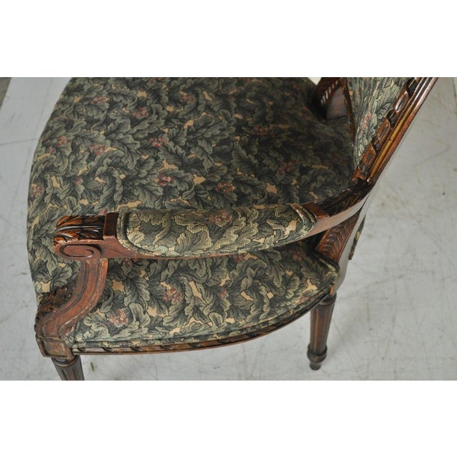 Item: Beautiful Vintage French Louis XVI Style Ornately Carved Oval Back Fireside Arm Chair. The piece features...