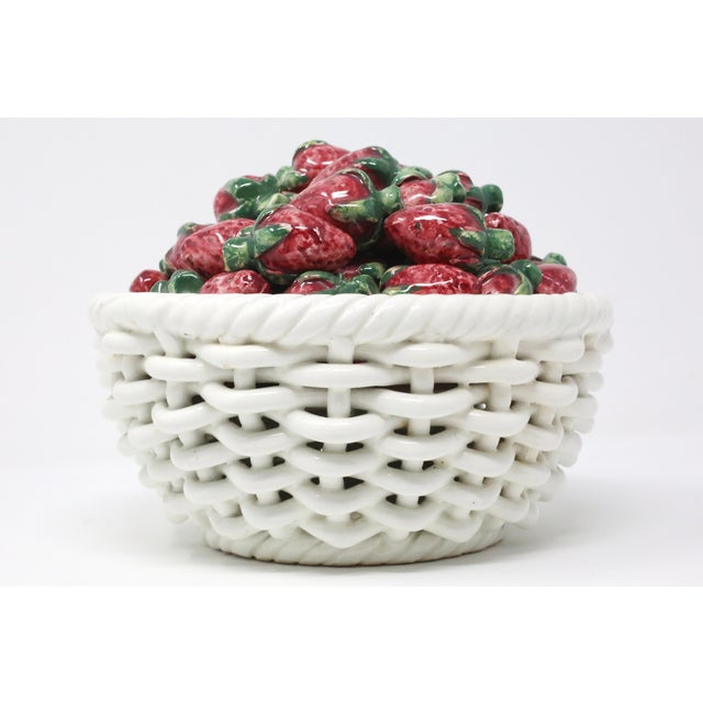 A vintage, ceramic basket filled with sculptural red and green strawberries. Good vintage condition; the bowl has a few...