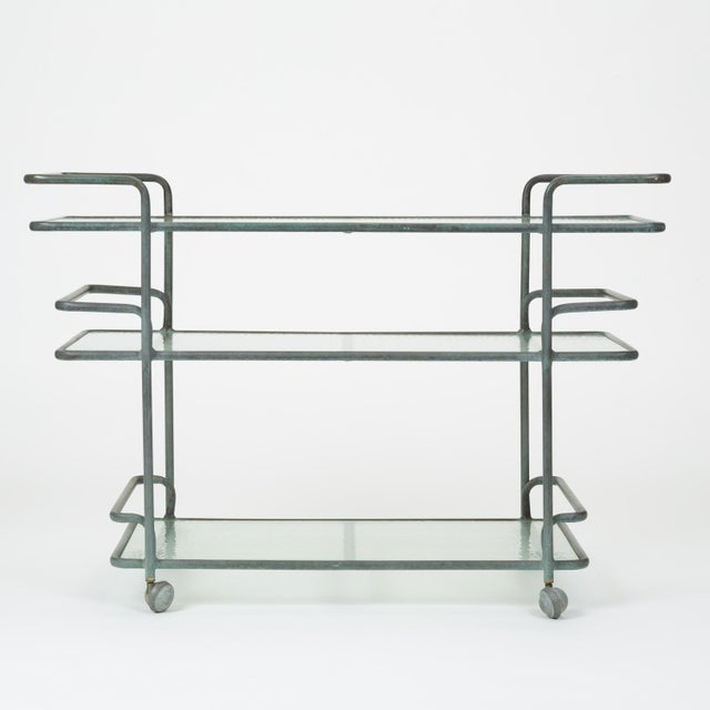 An outdoor bar cart on casters by Richard Frinier for Brown Jordan. The cart was designed during Frinier's tenure as...