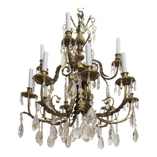 Circa 1920 French Louis XVI Style Bronze and Crystal 12 Lights Chandelier For Sale