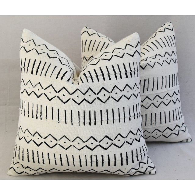 Pair of large pillows custom-tailored from vintage/professionally dry-cleaned handwoven and channeled African cotton mud...