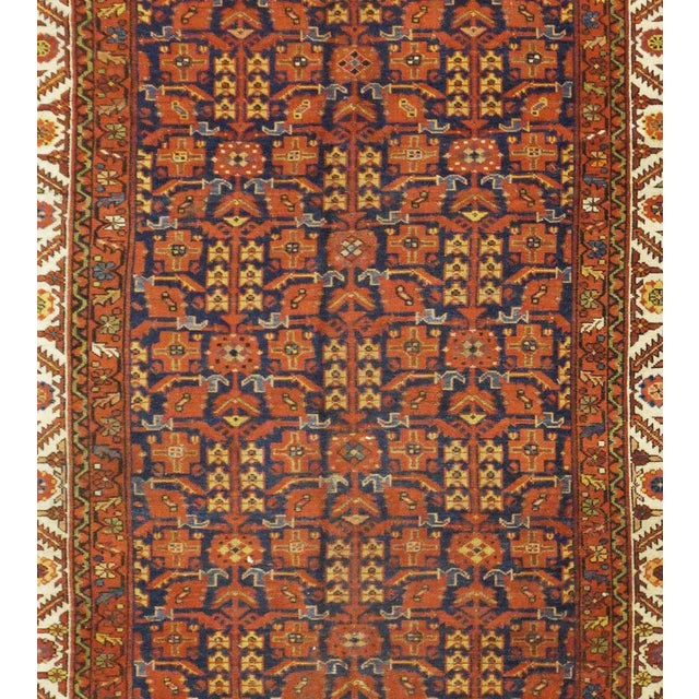 This beautiful rug is hand made, made in Iran. It features a pattern in a vibrant combination of orange, red, ivory,...