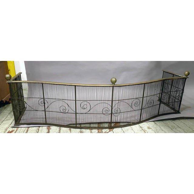 Wonderful 18th century Wire and brass bowed front fireplace fender . Nice wire decoration and Brass Ball decoration. 48''...