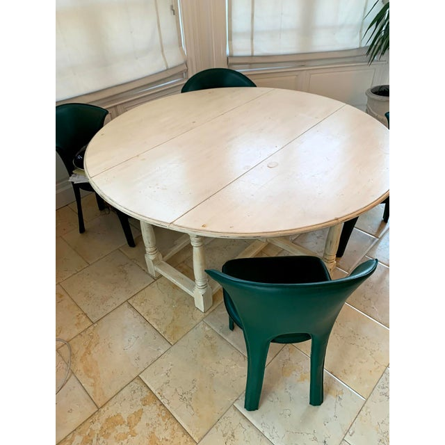 Beautiful kitchen/dining table in natural/creamy white finish. Side panels fold down and can be used as a console table as...